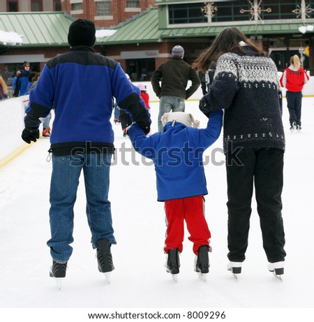 family ice skating - stock photo