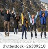 Family in a and outdoor winter setting. Jumping in joy! Slight motion bluriness is intended. - stock photo