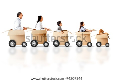 Family in a car made of cardboard box - express delivery concepts - stock photo