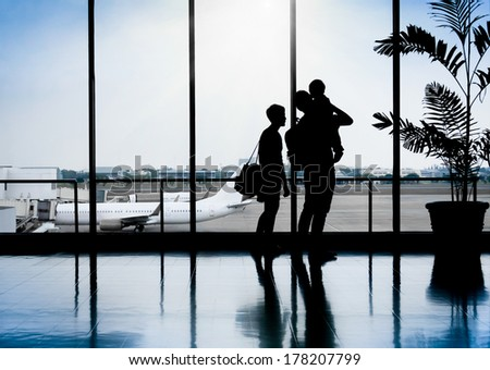 Family in a nice moment at Airport waiting for departure - stock photo