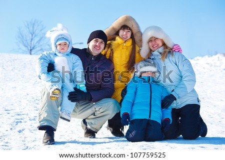 Family in a winter park - stock photo