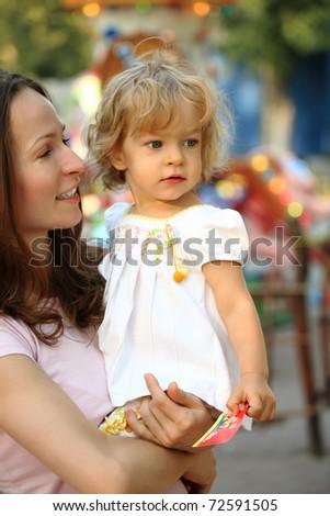 Family in amusement park - stock photo