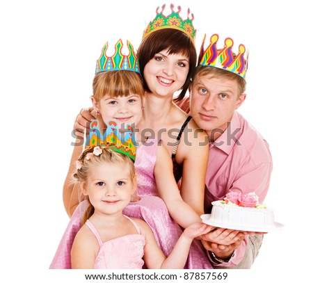 Family in birthday crowns holding cake, isolated - stock photo