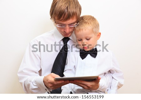 Family in business style working at home - stock photo