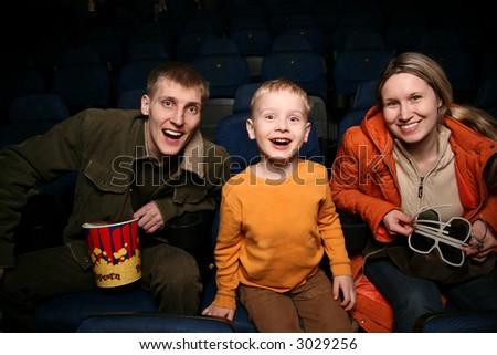 family in cinema - stock photo