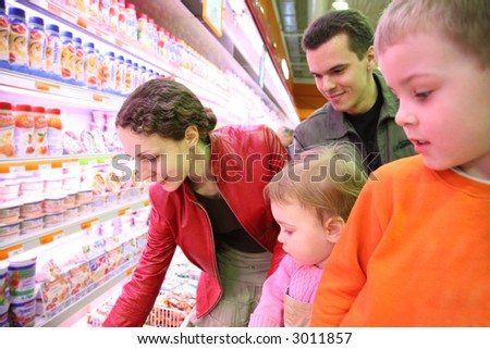 family in food shop - stock photo