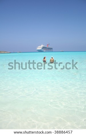 Family in front of a cruise ship - stock photo