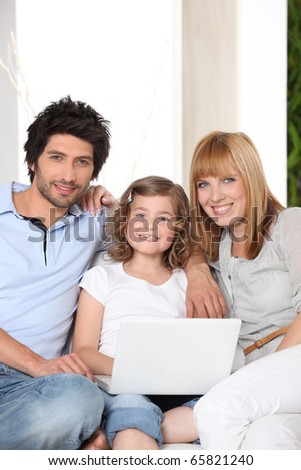 Family in front of a laptop computer