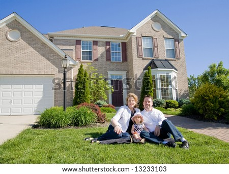Family in Front of House - stock photo