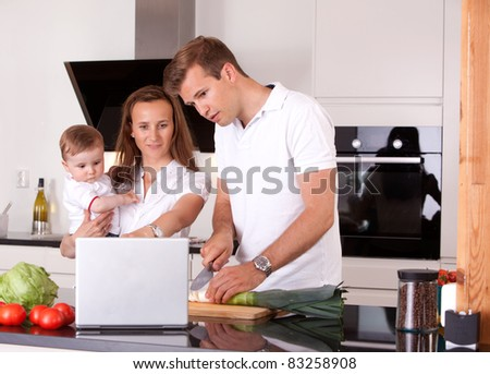 Family in Kitchen Preparing Meal - stock photo