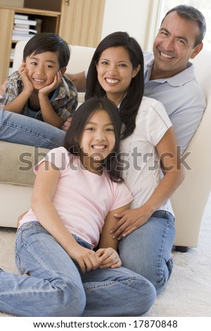 Family in living room smiling