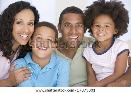 Family in living room smiling - stock photo