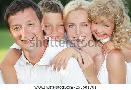 Family in summer park. Mother, father and children outdoors - stock photo
