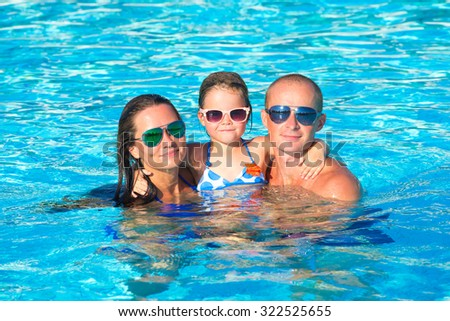 Family In Swimming Pool - stock photo