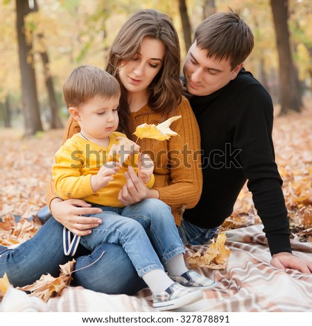 Family in the autumn park - stock photo