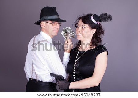 Family in the form of gangsters. Studio shot. - stock photo