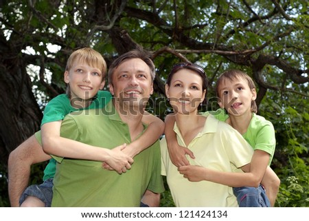 family in the green jersey in a summer park