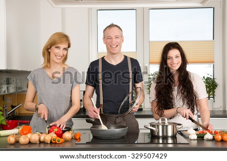 Family in the kitchen - stock photo