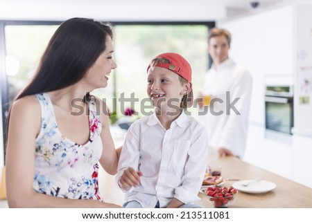 family in the kitchen at breakfast - stock photo