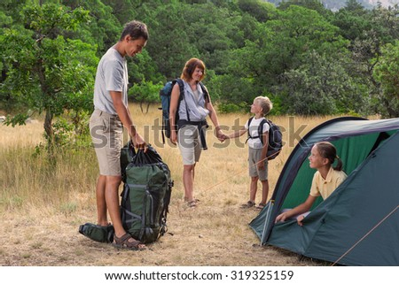 Family in the summer camping