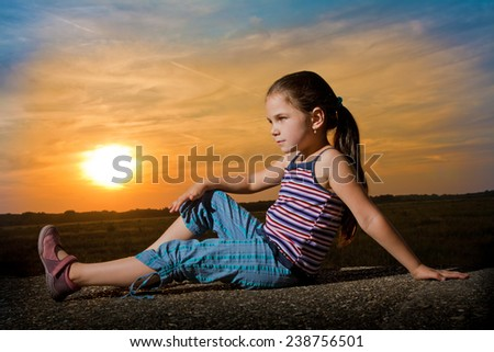 Family in the sunset - stock photo