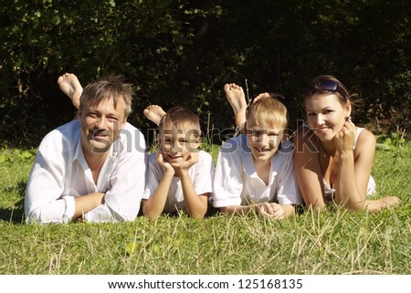 family in the white jersey in a summer park