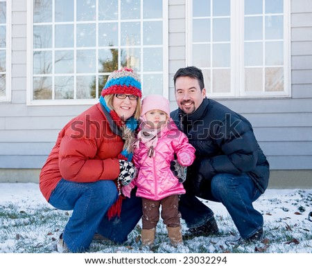Family in the Winter at Home - stock photo