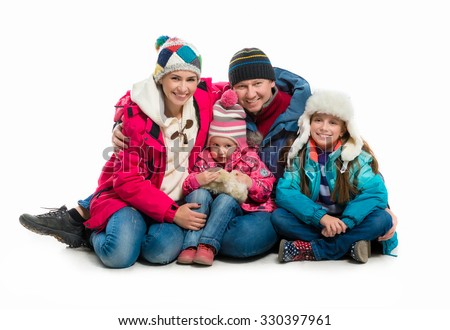 family in warm clothes alltogether isolated on white background - stock photo