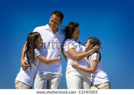 Family in white shirts - stock photo
