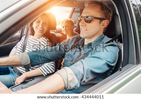 Family into the car - stock photo
