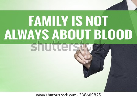 Family Is Not Always About Blood word on green virtual screen touching by business woman - stock photo