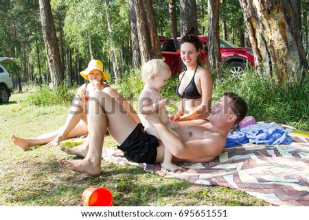 Family is resting on a picnic