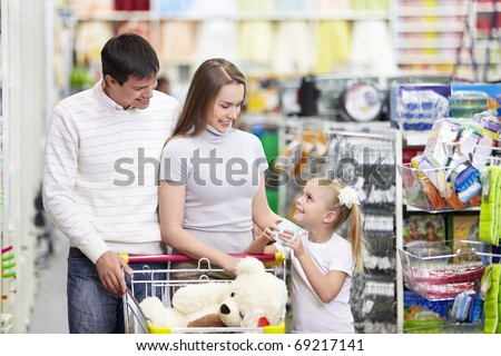 Family is shopping at the store - stock photo