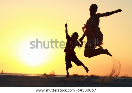 Family jumping - stock photo