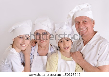 family knead the dough for the pie together - stock photo