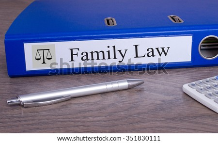 Family Law blue binder on desk in the office