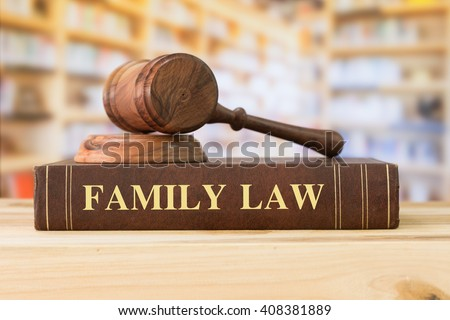 family Law books with a judges gavel on desk in the library. Law education ,law books ,family law concept.  - stock photo