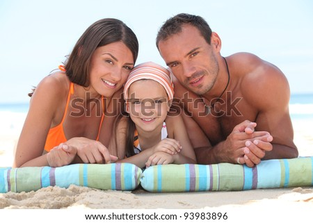 Family laying on beach