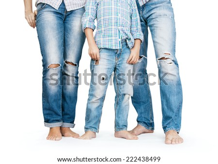 Family legs in tattered jeans  - stock photo