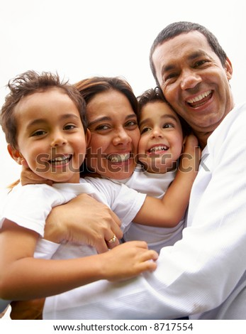 family lifestyle portrait of a mum and dad with their two kids having fun outdoors