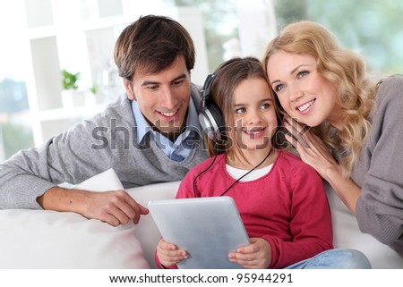 Family listening to music with tablet - stock photo