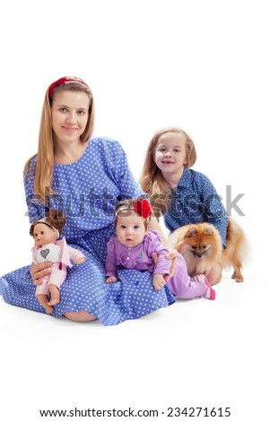 Family look photo of mother and two children with a dog - stock photo