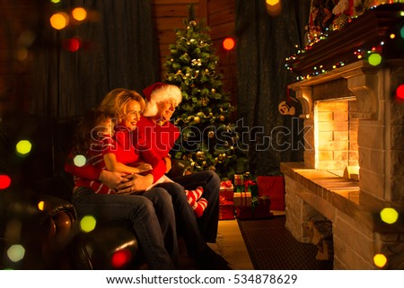 Family looking at fireplace in Christmas decorated house interior