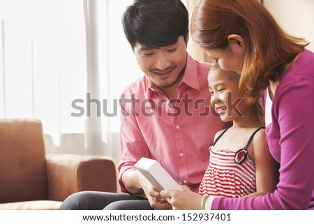 Family Looking at Picture Together