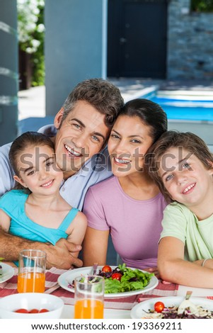 family lunch home couple with children, eating happy love smile, sitting at dinner table - stock photo