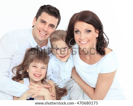 Family lying down on their bed at home