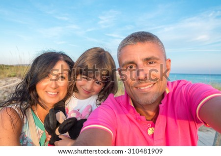 Family making a selfie on a tropical beach.