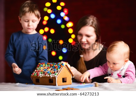 Family making gingerbread house