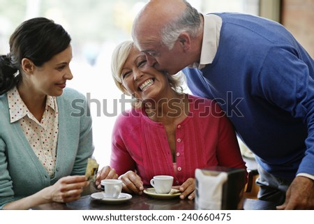 Family Meeting in Cafe - stock photo