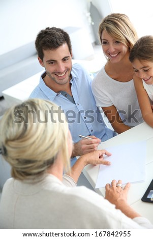 Family meeting real-estate agent for house investment - stock photo